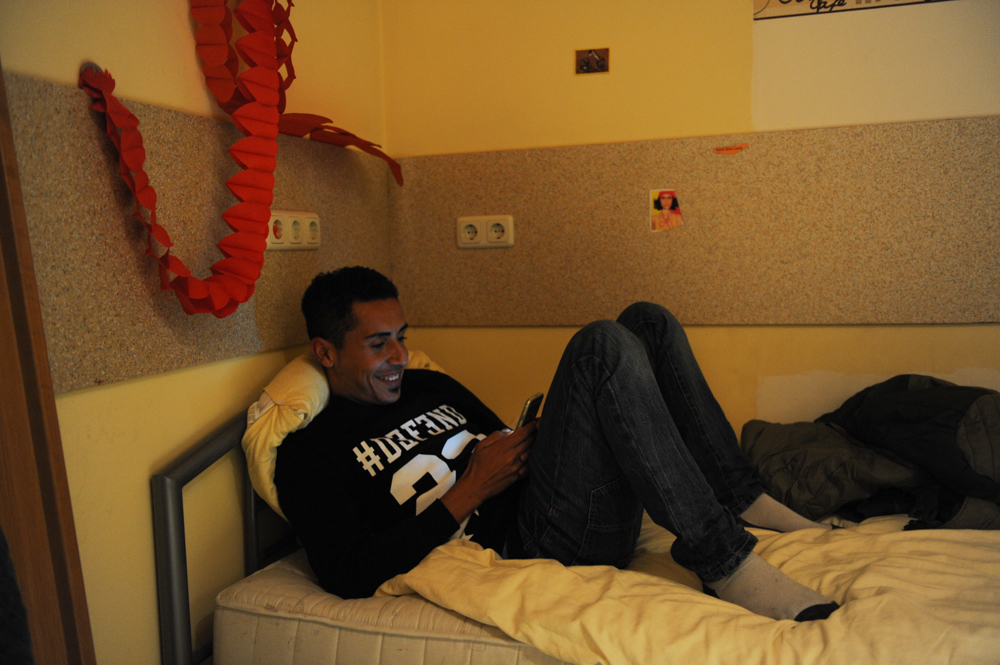 HERSBRUCK, GERMANY.  Fawaz Al Abed from Al-Bukamal, Syria, rests in his room at a hostel converted to refugee housing in the Nuremberg suburb of Hersbruck on September 24, 2015.  Al Abed has tried to apply for asylum in Germany and failed twice because he was fingerprinted by Bulgarian authorities, where he spent six months in prison after being caught entering the country illegally, and says that if he were allowed to stay in Germany, he would {quote}be celebrating the same if I get married, but I don't have any hope.{quote}