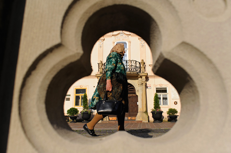 KOSICE, SLOVAKIA.  An old woman or babka walks down the Main Street early in the morning on June 3, 2010.
