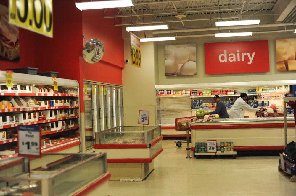 CHICAGO, ILLINOIS.  Workers in the dairy section of the Save-A-Lot at 10700 S. Halsted in the Morgan Park neighborhood on January 2, 2015.  At this Save-A-Lot location, a gallon of milk costs $3.29, a carton of eggs costs $2.49, a pound of ground beef costs $2.99, a can of tuna costs 79 cents and a loaf of bread costs $1.29.