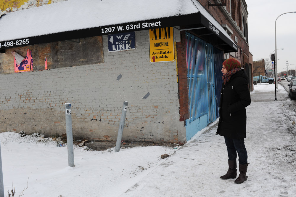 CHICAGO, ILLINOIS.  Sara Hamdan of the Inner-City Muslim Action Network (IMAN) stands in front of Alot To Save Food at 1207 W. 63rd Street in the Englewood neighborhood on January 5, 2015.  IMAN works with corner store owners in low income neighborhoods to provide customer and storeowner alike with fresh fruit and produce.