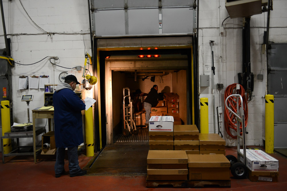 CHICAGO, ILLINOIS.  Workers prepare for morning pick-ups at the loading dock of Cougle Wholesale Poultry and Meats in the Fulton Market meatpacking district of the West Loop on December 22, 2014.  Cougle is a niche processor, processing poultry and meat on a scale that fits mid-market needs.
