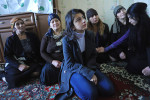 BAKU, AZERBAIJAN.  (Center) Gamar Tagili, 15, the daughter of slain writer Rafiq Tagi, sits with her mother (behind and to the left), the widow Maila Tagiyeva, 47, and Tagi's two sisters (behind and the two to the right) Yeguna and Durdana, during the third-day memorial in his apartment surrounded on November 26, 2011.  A critic until his very last article of Iran's theocratic regime with a fatwa ordered against his life by the late Iranian Ayatollah Fazil Lankarani and others in 2006, Tagi was once imprisoned for eight months in 2007 by Baku's secular ruling Aliyev family and stabbed repeatedly by a silent, unknown assailant while returning home the evening of November 19 and died of complications after having his spleen removed several days later; after initial silence, Azerbaijan authorities have opened an investigation and many of Azerbaijan's intelligentsia point their finger at Iran despite an official denial from the Iranian Embassy in Baku.