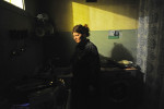 BAKU, AZERBAIJAN.  Maila Tagiyeva, 47, cooks dinner by light of the bathroom after the kitchen's single light bulb went out on the first day of the Novruz holiday celebrating the Zoroastrian new year on March 20, 2012.