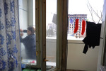 BAKU, AZERBAIJAN.  Maila Tagiyeva, 47, closes the cabinet of her outdoor cold storage on the family's terrace off the kitchen of the family's apartment on March 16, 2012.