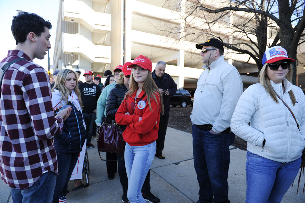 CHICAGO, ILLINOIS. Supporters of Republican Presidential front runner Donald Trump wait in line on the University of Illinois Chicago (UIC) campus to hear Trump speak at an event scheduled for the early evening on March 11, 2016.  Trump cancelled the event citing a request from the Chicago Police after scuffles broke out between his supporters and protesters, who had claimed a large number of the seats, before he was to speak, something the Chicago Police denied, which maintain they were ready to work the whole night.