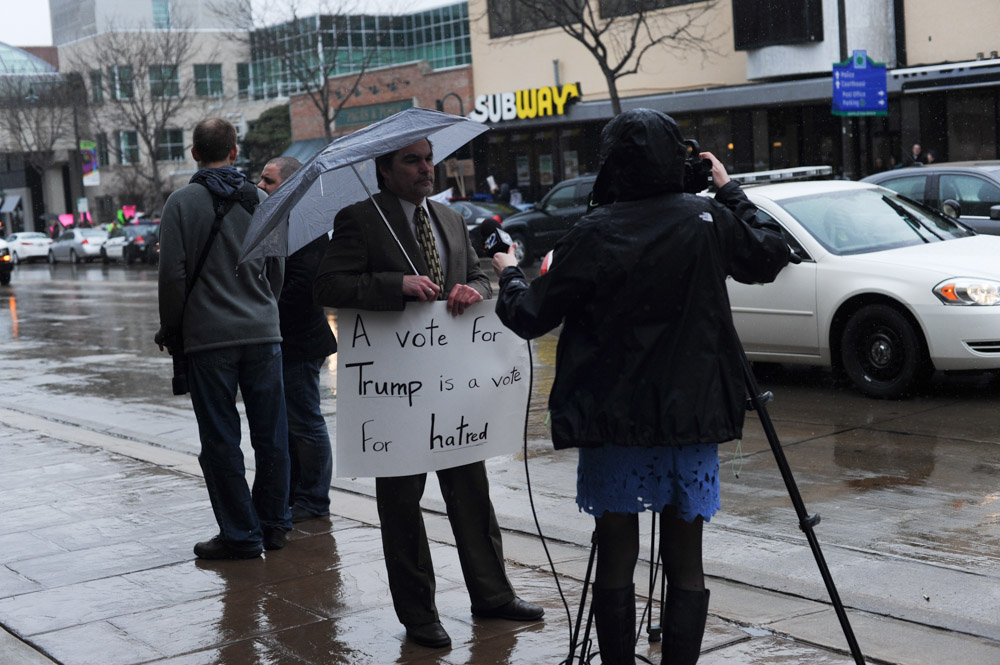 APPLETON, WISCONSIN.  A protester is interviewed in front of the Radisson Paper Valley Hotel before Republican presidential frontrunner Donald Trump speaks on March 30, 2016.