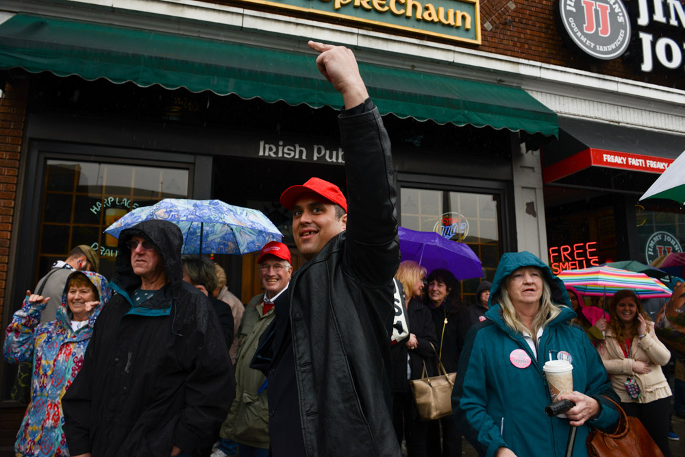 APPLETON, WISCONSIN.  Supporters of Republican Presidential frontrunner Donald Trump photograph and taunt protesters demonstrating across the street from the Radisson Paper Valley Hotel before Trump speaks on March 30, 2016.