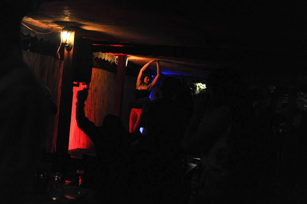 BELGRADE, SERBIA.  A woman dances on the table at Jos Ovu Noc, a kafana, or bar with live turbofolk music that blares late into the night on July 2, 2015.  Such clubs as showcases for turbofolk singers and bands have their origins along the Ibarska Magistrala highway which goes south from the capital towards the most traditional parts of Serbia.