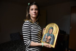 NIS, SERBIA.  Vladislava Djuric, 30, holds her nationally famous icon of Svetlana Raznatovic, better known as Ceca, which garnered national headlines after pictures went viral of it taken during a student exhibition at Djuric's university, on July 10, 2015.  Ceca, a turbofolk star better known as {quote}the Mother of Serbia,{quote} was married to one of the Bosnian War's most notorious Serbian military commanders, Arkan, who was later assassinated, and was one of a rotating cast of turbofolk stars who gave daily concerts in Belgrade's Republic Square during the 1999 NATO bombing.