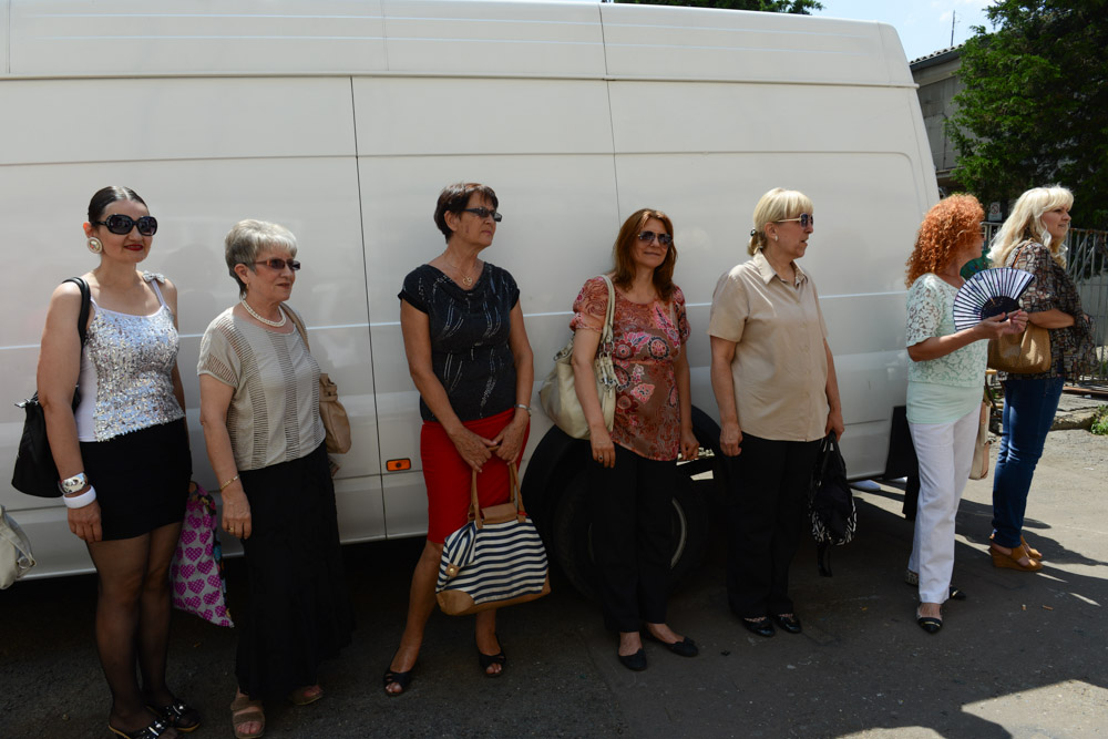 BELGRADE, SERBIA.  Members of the studio audience wait to enter the studio for a taping of {quote}Zvezde Granda,{quote} or {quote}Grand Stars,{quote} a premier turbofolk showcase on Serbian television, on July 1, 2015.  Members of the studio audience are paid 500 dinars, approximately $5, a day for their role and participation in the tapings which last for hours.