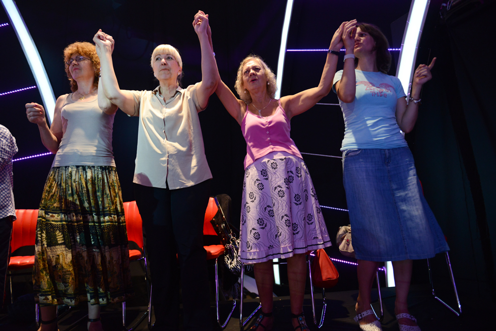 BELGRADE, SERBIA.  Members of the studio audience sing along to their favorite stars turbofolk hits on the set of {quote}Zvezde Granda,{quote} or {quote}Grand Stars,{quote} a premier turbofolk showcase on Serbian television station TV Prva, on July 1, 2015.  Members of the studio audience are paid 500 dinars, approximately $5, a day for their role and participation in the tapings which last for hours.