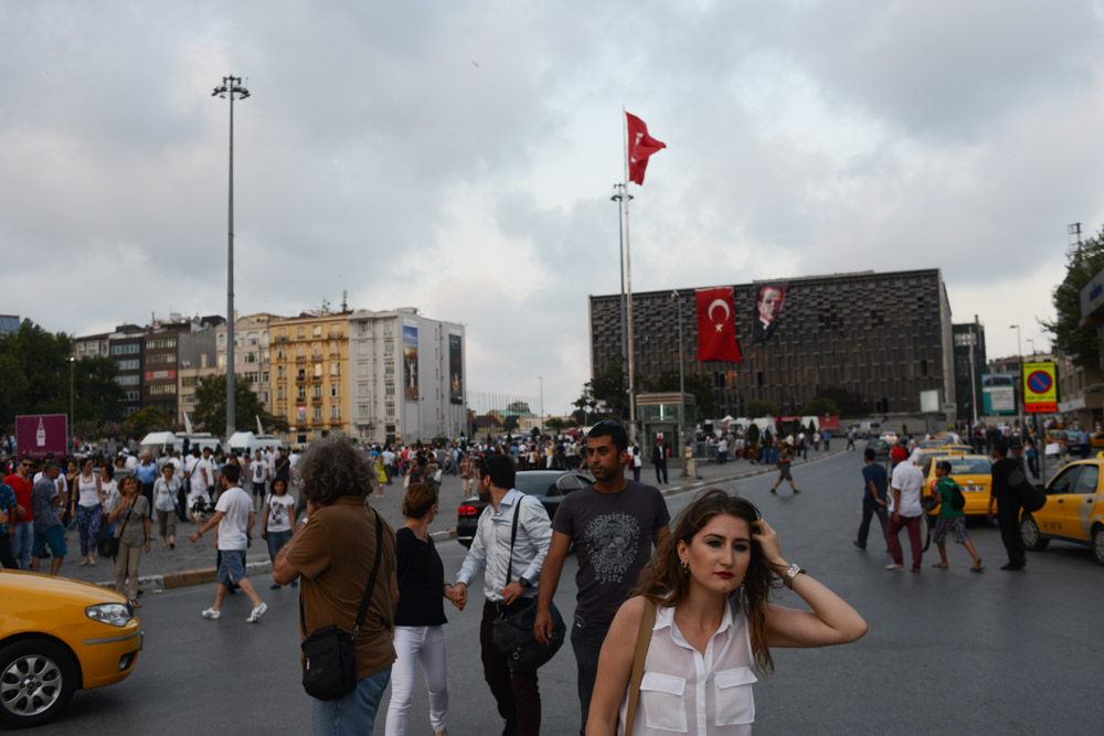 ISTANBUL, TURKEY.  A woman walks through Taksim Square just before the start of Ramadan at sundown on July 9, 2013.  Since demonstrators occupied the adjacent Gezi Park for two and a half weeks last month, police have maintained a heavy presence in Taksim Square and periodic clashes have erupted as demonstrators have returned to the square in protest of Prime Minister Recep Tayyip Erdogan.