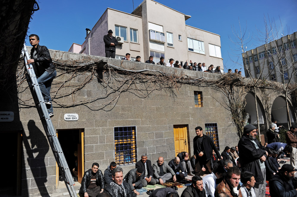 DIYARBAKIR, TURKEY.  Men pray outside the Nebi mosque, an official Turkish mosque with an imam approved by the Turkish state, during Friday prayers on February 24, 2012.