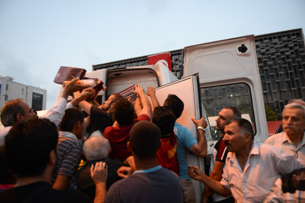 ISTANBUL, TURKEY.  People push their way to receive a free Iftar dinner sponsored by the Beyoglu municipality in Taksim Square at the start of Ramadan on July 9, 2013.  Since demonstrators occupied Gezi Park for two and a half weeks last month, police have maintained a heavy presence in Taksim Square and periodic clashes have erupted as demonstrators have returned to the square in protest of Prime Minister Recep Tayyip Erdogan.