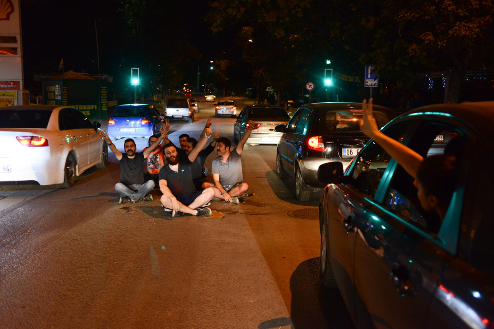 ANKARA, TURKEY.  People stage a sit-in against police brutality and the leadership of Prime Minister Recep Tayyip Erdogan in the middle of Kennedy Street on July 11, 2013.