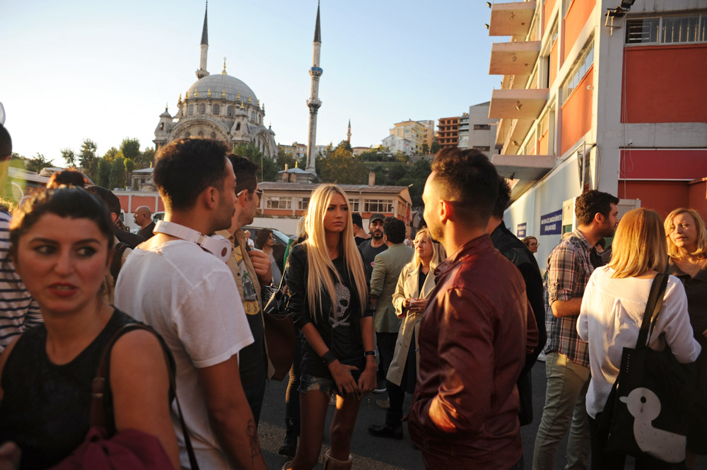 ISTANBUL, TURKEY.  A crowd gathers outside Antreppo 3, a warehouse-like facility on the Bosphorous in Tophane beside the Istanbul Modern art museum, after Simay Bulbul's Spring/Summer 2013 are seen at Istanbul Fashion Week on October 11, 2012.
