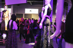 ISTANBUL, TURKEY.  Women are seen admiring different fashions showcased in the entrance at Antreppo 3 after the Erol Albayrak fashion show during Istanbul Fashion Week on October 11, 2012.