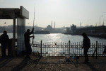 ISTANBUL, TURKEY.  Fisherman are seen on the Karakoy shore beside the Galata Bridge on January 11, 2014.