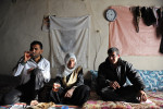 FIS, TURKEY.  Villagers eat lunch and drink tea in their home on February 24, 2012.  Fis is known as one of the first meeting places of arrested Kurdish Workers' Party, PKK, guerrilla leader Abdullah Ocalan;  Fis used to be home to 70 families but the Turkish military destroyed much of the town repeatedly in 1993-1994 in retalliatory strikes for the villagers show of sympathy to the PKK guerrillas who they provided food and shelter to ({quote}They are our sons,{quote} in the words of one villager), and now only seven homes have been rebuilt in Fis after a period of forced exile from the village and everyone is too scared to provide their name.