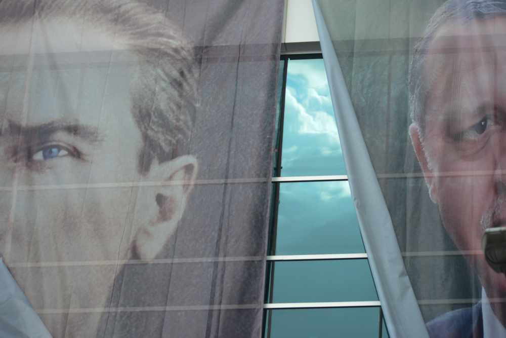 SINCAN, TURKEY.  Posters of Mustafa Kemal Ataturk, the founder of Turkey's secular republic, and Turkish Prime Minister Erdogan are seen adorning the facade of a building in Kent Square during a Justice and Development Party, AKP, rally where Prime Minister Recep Tayyip Erdogan was to speak after more than two weeks straight of protests across Turkey against his rule on June 15, 2013. Sincan is the site of the 1997 {quote}post-modern coup{quote} and where Turkish Prime Minister Recep Tayyip Erdogan chose for his Ankara rally to bolster his position with regard to ongoing protests in Istanbul's Taksim Square and across Turkey; at his rally he said that the security services would promptly take care of the protesters and shortly after riot police were unleashed on the peacefully gathered demonstrators who quickly retook the square.