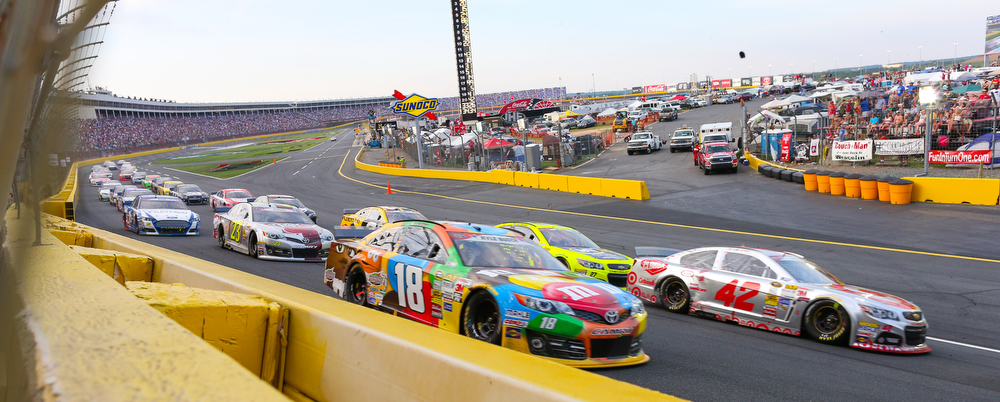 Driver Kyle Busch (18) and the rest of the field make their way through turn one during the Coca Cola 600 NASCAR race Sunday, May 25, 2014 at Charlotte Motor Speedway. Photo by JASON E. MICZEK - Special to the Independent Tribune
