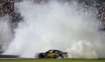 Jimmie Johnson does a burnout after winning the Coca Cola 600 NASCAR race Sunday, May 25, 2014 at Charlotte Motor Speedway. Photo by JASON E. MICZEK - Special to the Independent Tribune