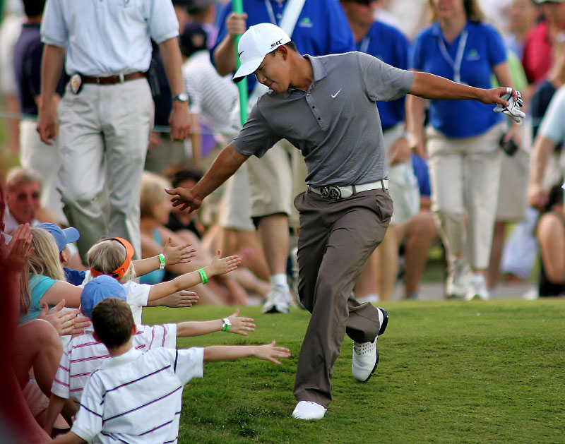 Anthony Kim low-fives the gallery en-route to his win at the 2008 Wachovia Championship.