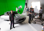 NASCAR driver Dale Earnhardt, Jr. is seen behind the scenes filming a commercial for the new Mountain Dew Baja Blast beverage Tuesday, April 22, 2014 on set at Hammerhead Studios in Mooresville, NC. (Photo by Jason E. Miczek / The Associated Press for Mountain Dew)