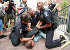 A protester is detained and arrested by Charlotte-Mecklenburg Police Department officers after he tried to trespass onto private property outside the Bank of America annual shareholders meeting in Charlotte, North Carolina, May 9, 2012. REUTERS/Jason E. Miczek  (UNITED STATES)