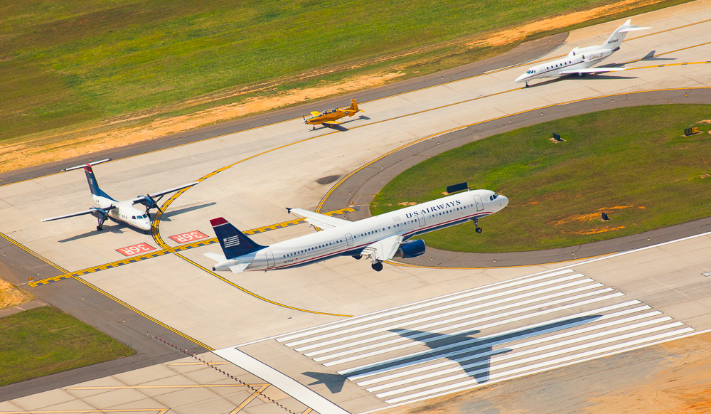 Four different styles of aircraft use one of Charlotte Douglass International's runways in Charlotte, NC.