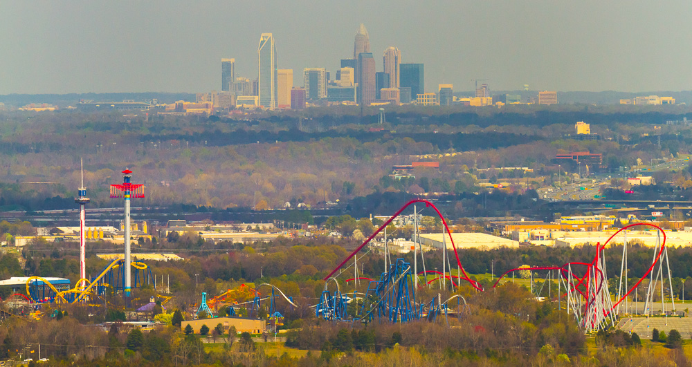 In the foreground - Carowinds themepark in South Carolina is seen with North Carolina's biggest city - Charlotte in the background.