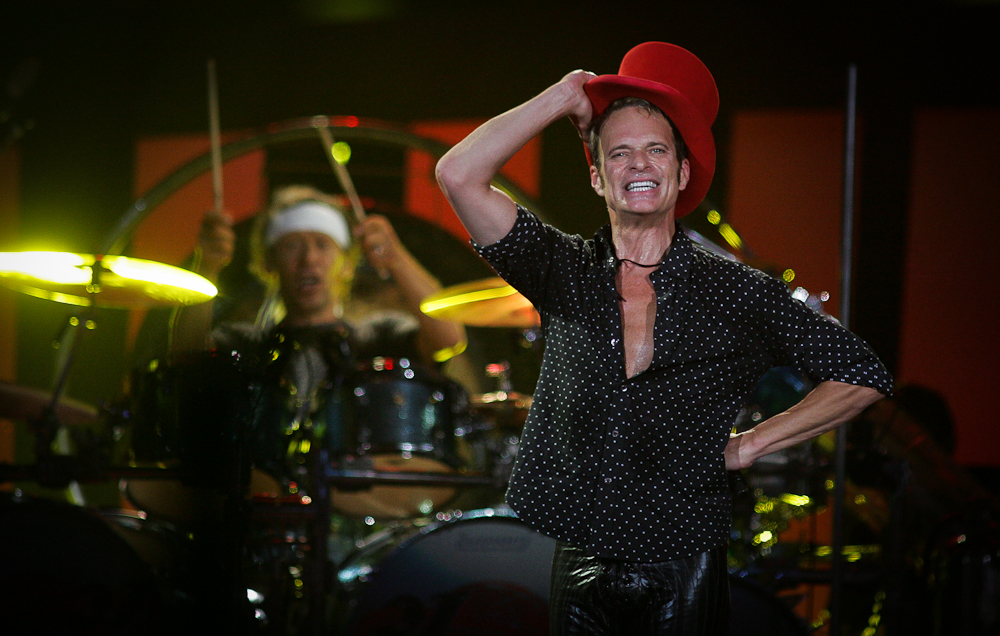 Singer David Lee Roth performs the song \{quote}Runnin\' With The Devil\{quote} during Van Halen\'s concert Thursday (9/27/07) night at Charlotte Bobcats Arena in uptown Charlotte, N.C (AP Photo/Jason E. Miczek).