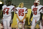 Leon High School kicker Daniel McRae, center, stands with her teammates before the start of their game against Mosley.