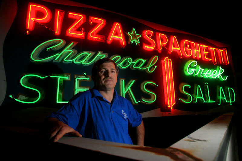 {quote}Little{quote} Bill Nickolopoulos, current owner of the Athens restaurant in downtown, is closing the business Sept. 30. Nickolopoulos took over the Charlotte late-night landmark after his father-in-law {quote}Big{quote} Bill Mantis passed away in January. The establishment has been in the family for 26 years and in Charlotte for more than 50 years. Nickolopoulos is pictured in front of one of the restaurant's roof-top neon signs.