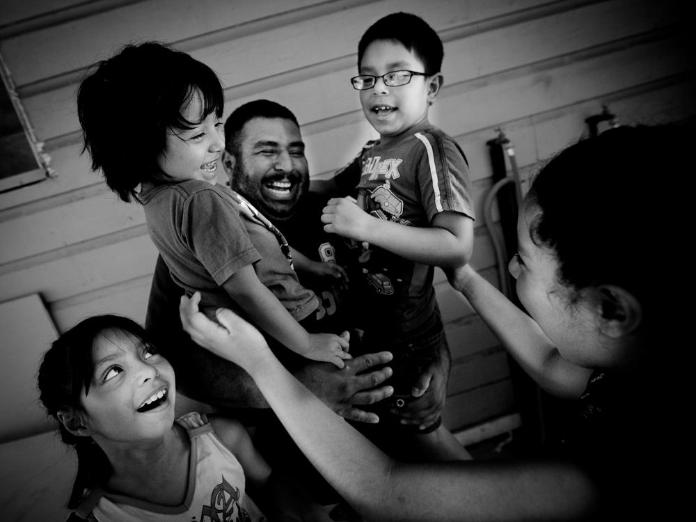 CASEY_KidsCount_SAN ANTONIO_167.cr2 - San Antonio, TX resident Manuel Luna and his family: wife, Laura and four children at their Texas home Monday, July 18, 2011.  Photo by JASON E. MICZEK - www.miczekphoto.com