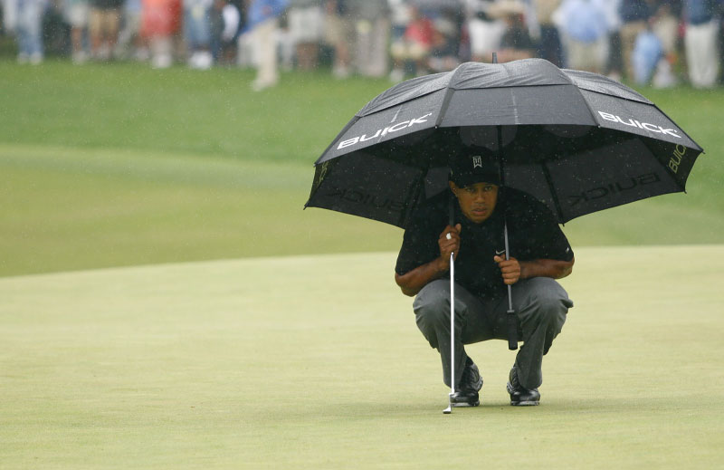 Tiger Woods in the rain at the Wachovia Championship.