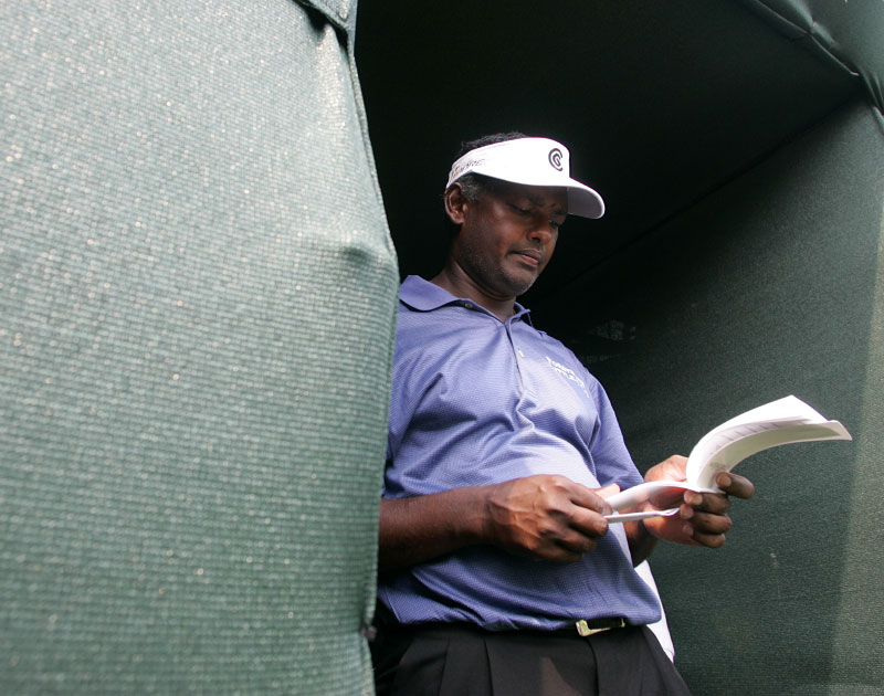 Vijay Singh checks his card at the turn during the 2007 Wachovia Championship.
