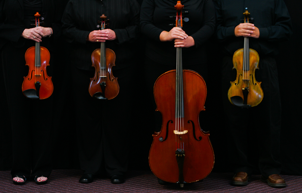 Members of \{quote}The 4 Bows\{quote} string quartet from left: violin players Ann Goode (CQ) and Anne Neely (CQ), Carrie Adams, cellist, and Dean Burgos (CQ), viola. The foursome will perform at the White House December 1, 2007. JASON E. MICZEK - Special to the Observer