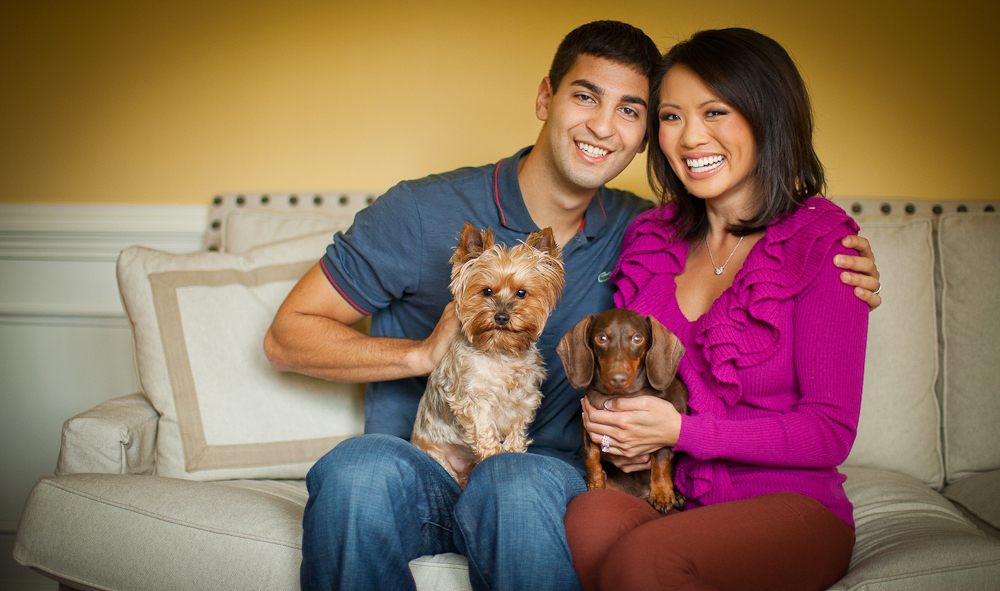 THIS IS FOR SOUTHPARK MAGAZINE - Charlotte couple Evan Panesis, a professional poker player and Dion Lim, WCNC News Channel 36 - 4 and 5:30 pm anchor are pictured at their home with their dogs \{quote}Georgie\{quote}, left, a yorkshire terrier and \{quote}Frankie\{quote}, a miniature dachshund Thursday, December 15, 2011. Photo by JASON E MICZEK - www.miczekphoto.com