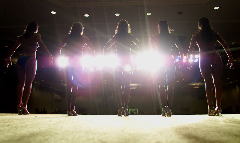 Five women line up on stage for the judges' consideration during prejudging at the XXVI annual NPC Southern USA at Edgewater Resort in Panama City Beach.