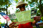 A fan looks at the schedule during the 2014 U.S. Open Experience at Tufts Park in Village of Pinehurst, N.C. on Wednesday, June 11, 2014.  (Copyright USGA/Jason Miczek)