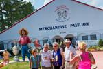 Fans outside of the merchandise tent during a practice round before the 2014 U.S. Open at Pinehurst Resort & C.C. in Village of Pinehurst, N.C. on Tuesday, June 10, 2014.  (Copyright USGA/Jason Miczek)