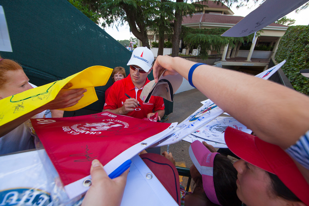 Zach Johnson signs autographs during a practice round before the 2014 U.S. Open at Pinehurst Resort & C.C. in Village of Pinehurst, N.C. on Wednesday, June 11, 2014.  (Copyright USGA/Jason Miczek)