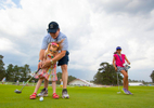 Families use the Thistle Dhu putting green during a practice round before the 2014 U.S. Open at Pinehurst Resort & C.C. in Village of Pinehurst, N.C. on Wednesday, June 11, 2014.  (Copyright USGA/Jason Miczek)