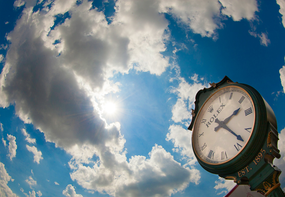A detail shot of the Rolex clock against the clouds during the second round of the 2014 U.S. Open at Pinehurst Resort & C.C. in Village of Pinehurst, N.C. on Friday, June 13, 2014.  (Copyright USGA/Jason Miczek)