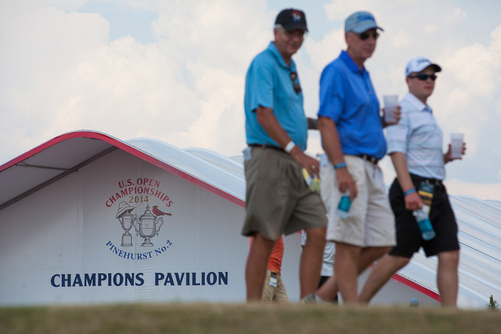 Fans walk the grounds during a practice round before the 2014 U.S. Open at Pinehurst Resort & C.C. in Village of Pinehurst, N.C. on Wednesday, June 11, 2014.  (Copyright USGA/Jason Miczek)