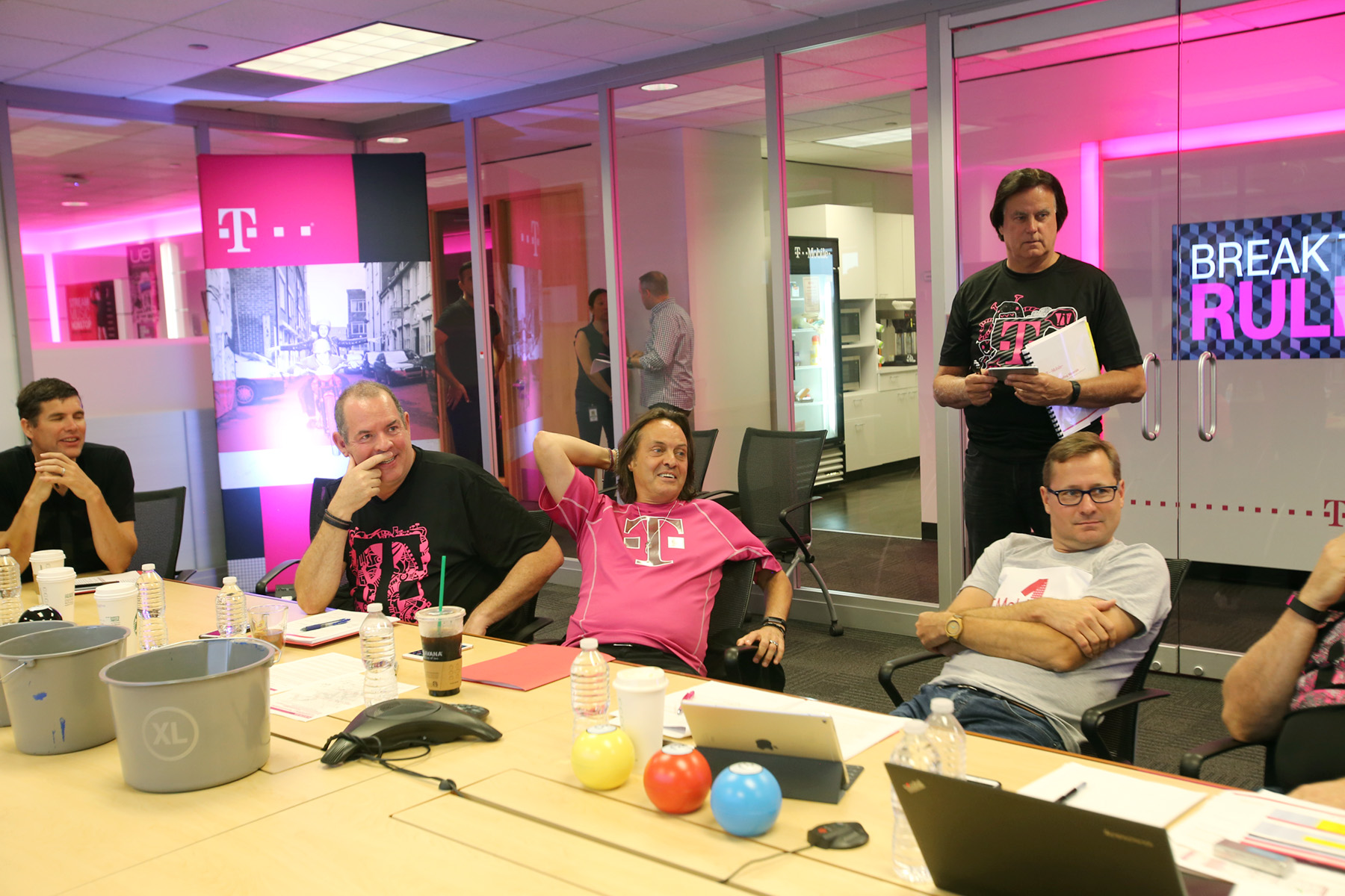 T-Mobile executives and communications team members are seen at the Un-carrier 12 announcement at T-Mobile headquarters in Bellevue, Wash.