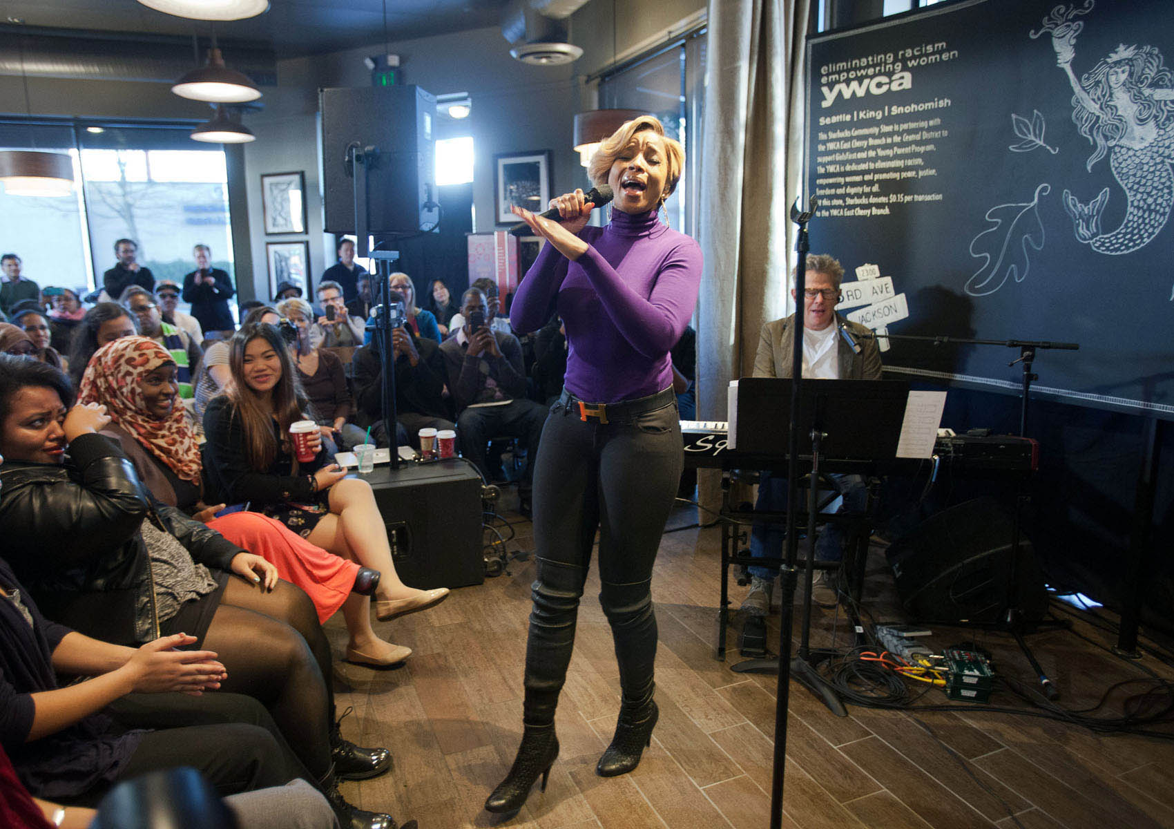 Mary J. Blige performs a private show at a Starbucks store.