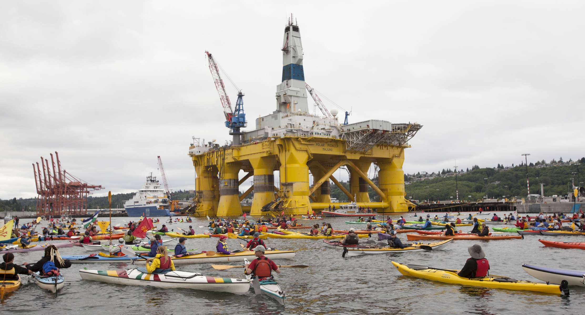 Activists in kayaks protest Saturday, May 16, 2015, near the Polar Pioneer, Shell Oil Company's  drilling rig, which is moored at the Port of Seattle's Terminal 5
