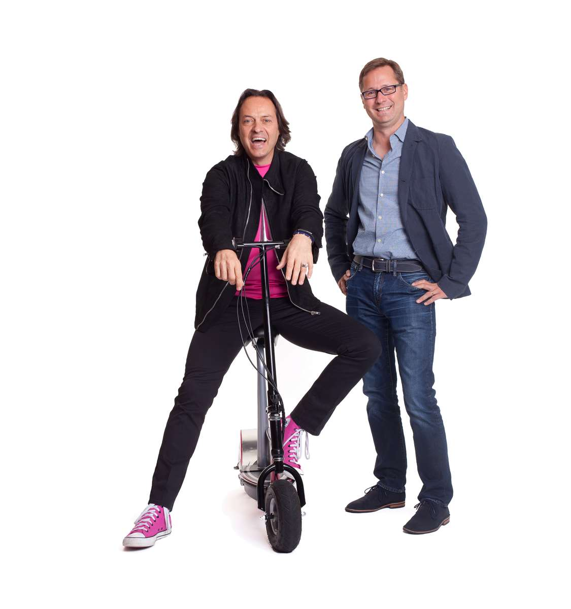 T-Mobile CEO John Legere, left, and CMO Michael Sievert at company headquarters in Bellevue, WA on Wednesday August 6, 2014. Photo by Ron Wurzer/Getty Images